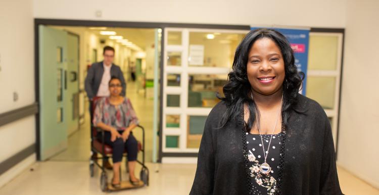 Woman standing in hospital corridor