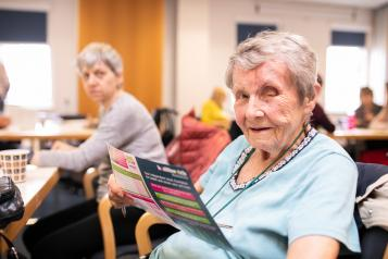 Lady reading Healthwatch flyer